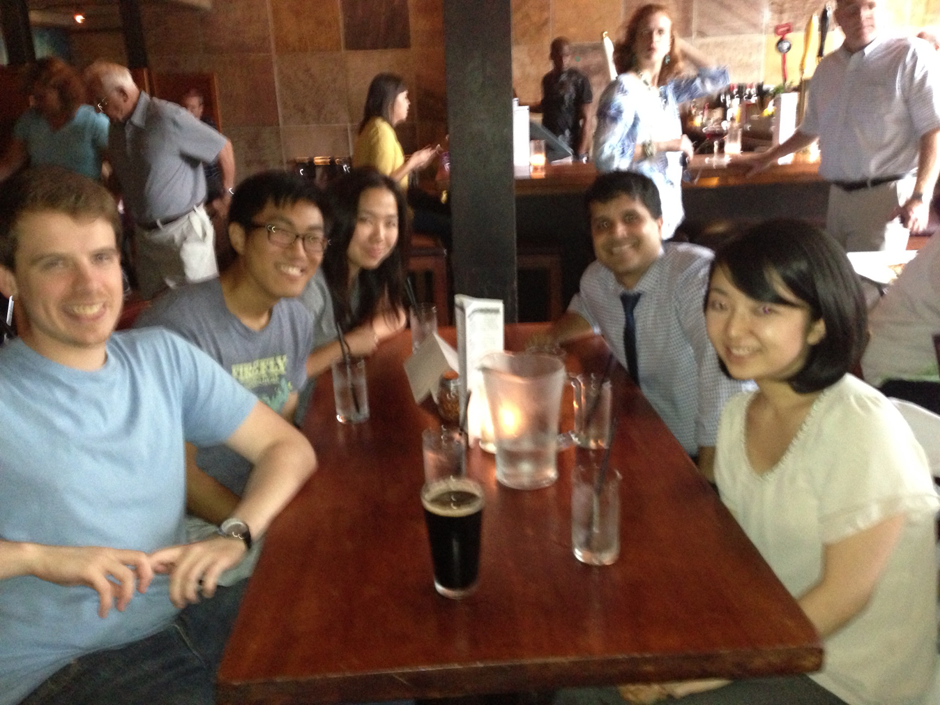 August 2013, Bar Pizza - Planning the Prank for our Lab Manager Returning from India after a Long Vacation (blurry photo but all we have.)